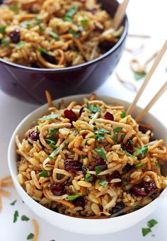 Crunchy Asian Rice Salad- This crunchy asian rice salad recipe is a true crowd pleaser! It's full of chow mein noodles, craisins, pine nuts, and an addictive soy garlic dressing. passthechallah.com
