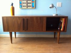 Kasse TV Stand With 12 Legs in Solid Walnut by STORnewyork on Etsy - delivers locally in NYC!