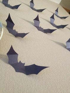 I have seen these bat scenes all over pinterest this year! I even saw a Martha Stewart set of pre-made bats in Michaels to do this, but if you have black paper, why spend the $6 bucks for 10 when y…