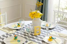 I've completely given up on fussy baby shower themes in favor of good food, fun games, and beautiful centerpieces.