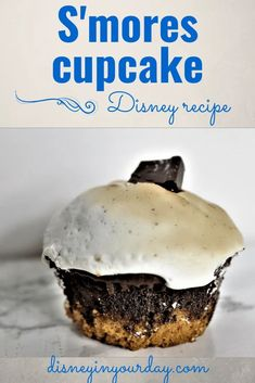 S'mores cupcake recipe - what's better than a tasty combination of chocolate, marshmallow, and graham cracker crumbs? When you combine them all into a cupcake! Similar to the one found at Wilderness Lodge, this will make you feel like you're around the campfire even when you're not. Disney in your Day #disneyfood #disneyrecipes #smores #smorescupcake #disneycupcakes #wildernesslodge Smores Cupcake Recipe, Cupcake Tray, Cupcake Recipes, Disney World Food, Disney Parks, Graham Cracker Crumbs, Graham Crackers, Disney Inspired Food, More Cupcakes