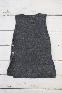 Inspired by my recent trip to Sweden, this useful vest is named after the wonderful botanist Carl Linnaeus. Warm and feminine with a lovely drape, the garment works well as a stand alone vest or as an extra layer over a blouse or long sleeved tee. The yarn is amazingly lovely to work with, showing up stitch detail well and allowing the shaping decreases to drape elegantly. The pattern is worked flat in two pieces and then seamed at both shoulders before working a clever moss stitch neckband…