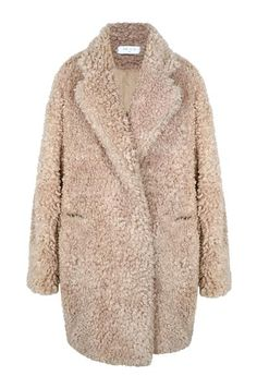 DESCRIPTION:Feel cozy in style this winter in this double breasted faux fur coat. Designed with a wool blend collar stand, the coat features front pockets and i