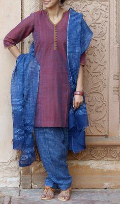 Lovely brown mangalgiri kurta with a beautiful neckline teamed with Indigo handprinted kota salwar dupatta