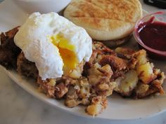 Corned beef hash with poached eggs and a homemade English muffin at The Blue Door Cafe & Bakery in Cuyahoga Falls, OH