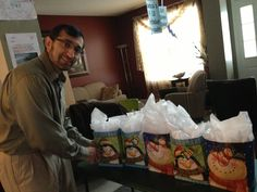 Dr. Aziz, getting ready to surprise the Smiles team with holiday gifts.