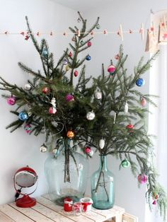 Thinking about having an alternative Christmas tree? Want to see the best ideas? We've rounded up the top 16 alternative Christmas tree ideas. Merry Little Christmas, Noel Christmas, Winter Christmas, Vintage Christmas, Christmas Crafts, Christmas Branches, Christmas Design, Green Christmas, Decorated Christmas Trees