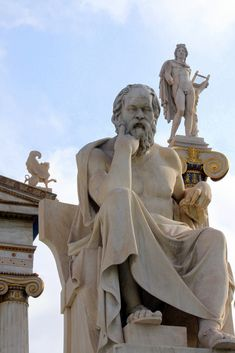 Neoclassical statues of Socrates (ancient Greek philosopher) and Apollo in front of the Academy of Athens, Greece.