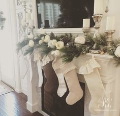Ruffled stockings hung on a pine and floral mantel with mercury glass candlesticks