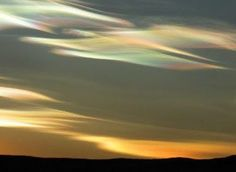 Nacreous clouds composed of ice crystals with temperatures of ~minus