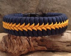 FISHTAIL PARACORD SURVIVAL BRACELET with CENTER STITCHING:    Colors Shown:  Brown with Gold Center Stitching    ==============================================================    All PARASPIRIT bracelets are hand-crafted with high-quality 550, 7-strand paracord. Your FISHTAIL PARACORD SURVIVAL BRACELET with CENTER STITCHING will be custom made according to the wrist measurement that you provide from the drop down menu. (see below for directions on how to measure for your wrist)    The…