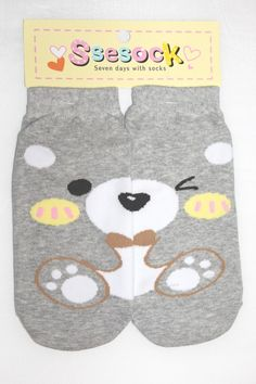 It's a cute pair of ankle socks with a grey bear picture on it.  Combine each half of the sock to make a complete picture!