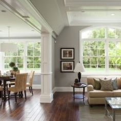 Love the molding separating the living / dining room. We need that. ---- traditional family room by Arch Studio, Inc.