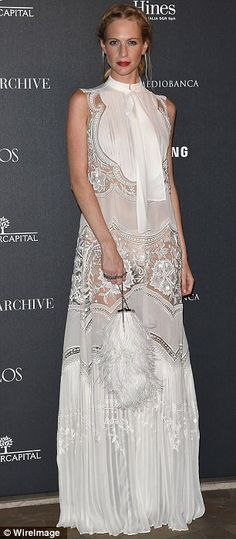 Racy in lace: Poppy's dress left little to the imagination with its lace cut-out panels hi...