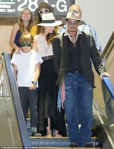 Where to next? Johnny Depp and girlfriend Amber Heard accompany his son Jack and daughter Lily-Rose (top left) at Tokyo's Narita airport on Thursday