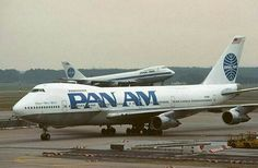 Pan Am 747's in contrasting liveries.