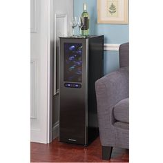 """This is the dual-temperature wine refrigerator that secures 18 bottles yet measures less than 10""""-wide. Ideal for narrow spaces—such as the end of an apartment's buffet or island—while providing the convenience of a fully stocked kitchen cellar, it stores Bordeaux-sized bottles with seven chrome shelves that pull out easily for readjustment when storing larger bottles from other appellations. A built-in shelf supports upright and preserved wines. Its thermoelectric cooling system operat..."""