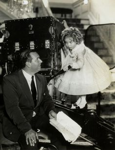 Shirley Temple with Director, David Butler, on the set of The Littlest Rebel, 1935.