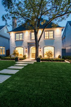 A gorgeous application photo in #Dallas Texas. This home features a number of #Bevolo styles. For the front entry, two Governors Lanterns were selected.