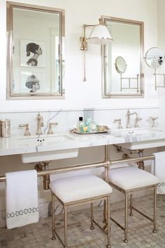 love this double sink and mirror combination — especially when those mirrors are recessed for plenty of extra storage space. This large mosaic tile grounds these chic and shiny fixtures