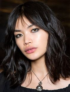Textured lob medium hairstyle messy low key easy styling casual bangs