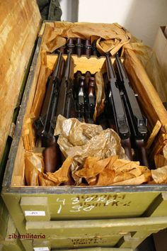 """A case of nearly-new M1A1 Thompson submachine guns that were deactivated in Russia and shipped to Zib-Militaria in Germany for commercial sale. Note the Cyrillic on the side of the crate indicating contents of 15 guns (15шт for """"штук"""", or """"piece"""")."""