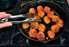 You don't really need  lot of oil to brown these, and using cast iron is always a healthier way to cook