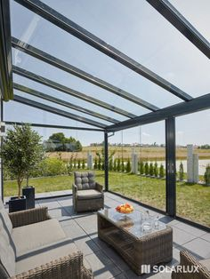 Terrassenüberdachung You can relax wonderfully in the light-flooded glass house - even if it is not Backyard Patio Designs, Pergola Designs, Sunroom Addition, Sunroom Decorating, Glass Extension, Casas Containers, Terrace Design, Marquise, Glass Roof