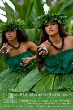 Hula kahiko dancers with 'ili'ili (stones used in hula) on Maui