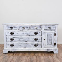 "This ""Open Hearth"" shabby chic dresser is featured in a solid wood with a distressed white chalk paint finish. This chest of drawers has a cabinet, eight spacious drawers, and bracket feet. Perfect for storing clothes and shoes! #shabbychic #dressers #shortdresser #sandiegovintage #vintagefurniture"
