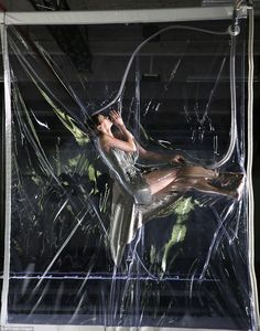 All in the name of fashion: Models were displayed in a vacuum pack for  Iris Van Herpen's AW14 show