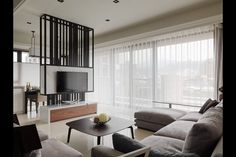 An elegant example of urban living in a Taipei, the capital of Taiwan created by DaChi International Design. Urban Living, Living Room Modern, Living Room Interior, Home Living Room, Room Divider Ideas Bedroom, Living Room Divider, Tv Feature Wall, Small Appartment, Living Room Tv Unit Designs