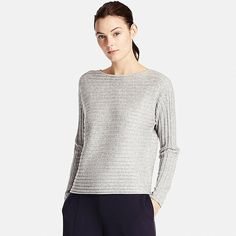 The softness of this sweater comes from a blend of wool and cashmere, the most luxurious of fabrics. The natural texture of cotton combines with the soft, fine texture of cashmere. Ribbed knit adds texture to the solid color. Features a flattering boatneck and popular dolman sleeve design.