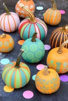 Who says Halloween has to just be orange and black? Use stencils and bright colored paint to give your pumpkins a fresh look.