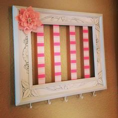Little girl's bow and head band holder made from an empty frame and ribbon.