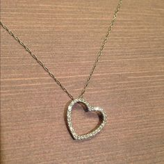"""Diamond Heart Necklace 14k White Gold Diamond heart necklace on dainty chain. 14k white gold encrusted with small diamonds. Chain measures 17"""". Heart can dangle on its side or straight. Diamonds sparkle in the light. Received as a gift. Jewelry Necklaces"""