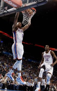 Westbrook throwing down another slam! OKC's Russell Westbrook, left, dunks the ball as Kevin Durant celebrates duirng a win against the Kings on Tuesday. Photo by Sarah Phipps, The Oklahoman