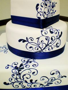 3 Tier fondant cake with handpainted scrollwork and satin ribbon