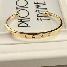 """2/$20 Gold/Silver LOVE Cuff Bracelet Pick a color silver or gold. New with tags great quality. New with tags available to ship today. MIX AND MATCH ALL JEWELRY WITH """"2/$20"""" IN THE TITLE 2 FOR $20, 3 FOR $26, 4 FOR $30. Please note that simply adding items to a bundle will not give you the correct discount. If you are interested in a bundle please leave a comment so I can make you a listing with the correct price :) Boutique Jewelry Bracelets"""