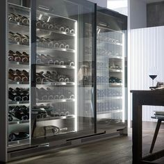 """Kitchen geniuses Arclinea have designed the perfect cabinet for keeping wines at an optimum temperature at home or in the restaurant - """"VINA"""". #antoniocitterio #kitchen #winefridge #madeinItaly #cucina"""