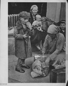 Hungry, poverty stricken families on the streets of Smolensk during World War…