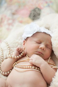 newborn girl pearls love this but would do it with feather headband instead