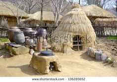 Traditional Kimchi Jar Storage Hut, Korean Folk Village in the city of Yongin, a satellite city in the Seoul Metropolitan Area - stock photo