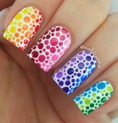 A subtle and fun way of making rainbow-inspired nails is through polka dots. However instead of scattering the colors, you can arrange them well to fit the colors of the rainbow and for a cleaner look.