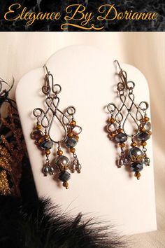 Dramatic Gothic Victorian Chandelier Earrings created with glowing black peacock pearls! Fabulous scrolling gunmetal wire work frames are graced with luscious black pearls and gunmetal crystals. #gothicvictorianearrings #gothicearrings #gothicjewelry #gothicchandelierearrings #gothicvictorianjewelry #gothicvictorian #victoriangothicearrings #victorianearrings #victorianjewelry  #blackpearlearrings #chandelierearrings #gunmetalearrings #etsyjewelry #etsyjewelrydesigner #etsy #etsyshop #gothic Victorian Jewelry, Victorian Gothic, Gothic Jewelry, Fantasy Jewelry, Vintage Jewelry, Black Pearl Earrings, Gothic Earrings, Etsy Jewelry, Handmade Jewelry