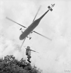 A Royal Marine Commando, probably of 40 Commando being lowered into the Borneo jungle from a Westland Wessex HU.5 probably of 845 Naval Air Squadron during the Indonesian Confrontation, 1964.