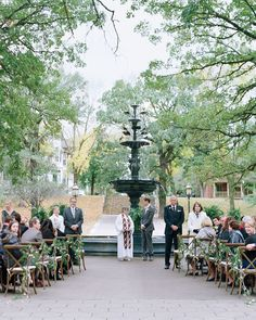 The duo wed in front of an 1881 three-tiered fountain. Wooden bistro chairs strung with floral garlands lined the aisle, and velvet cushions were placed up front for the wedding party of nieces, nephews, and godchildren. A local minister officiated the ceremony, which included readings from the Dalai Lama and the children's classic The Velveteen Rabbit.