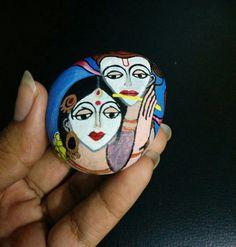 Radha Krishna rock painting
