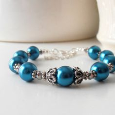 Peacock Wedding Jewelry Teal Pearl Bracelets Vintage Style Antiqued Silver Blue Green Beaded Bridesmaid Jewelry Bridesmaid Gift. $18.00, via Etsy.