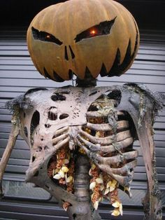 Use pumpkin innerds for guts. Very cool looking prop!